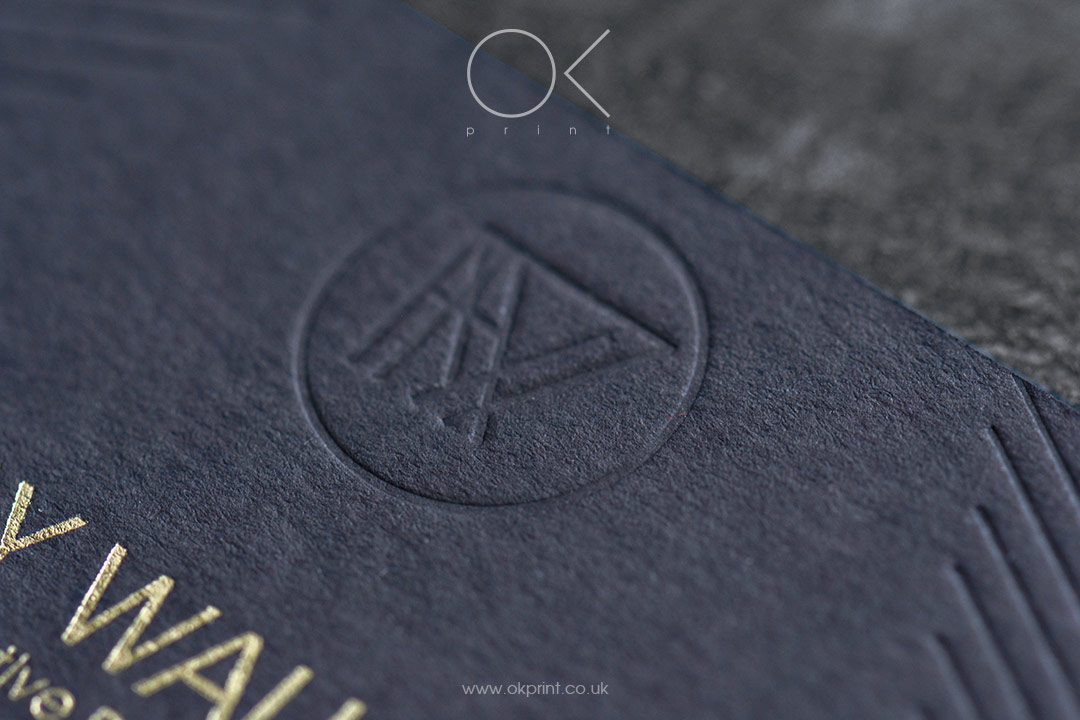 Black premium business cards with gold foiled logo ans debossing