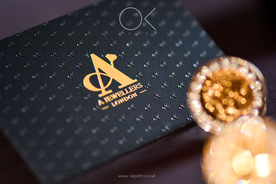 Luxury business cards with Rose-Gold foil and raised ink on duplexed black paper for Jewelry Company