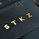 Golden foil black business cards with raised ink