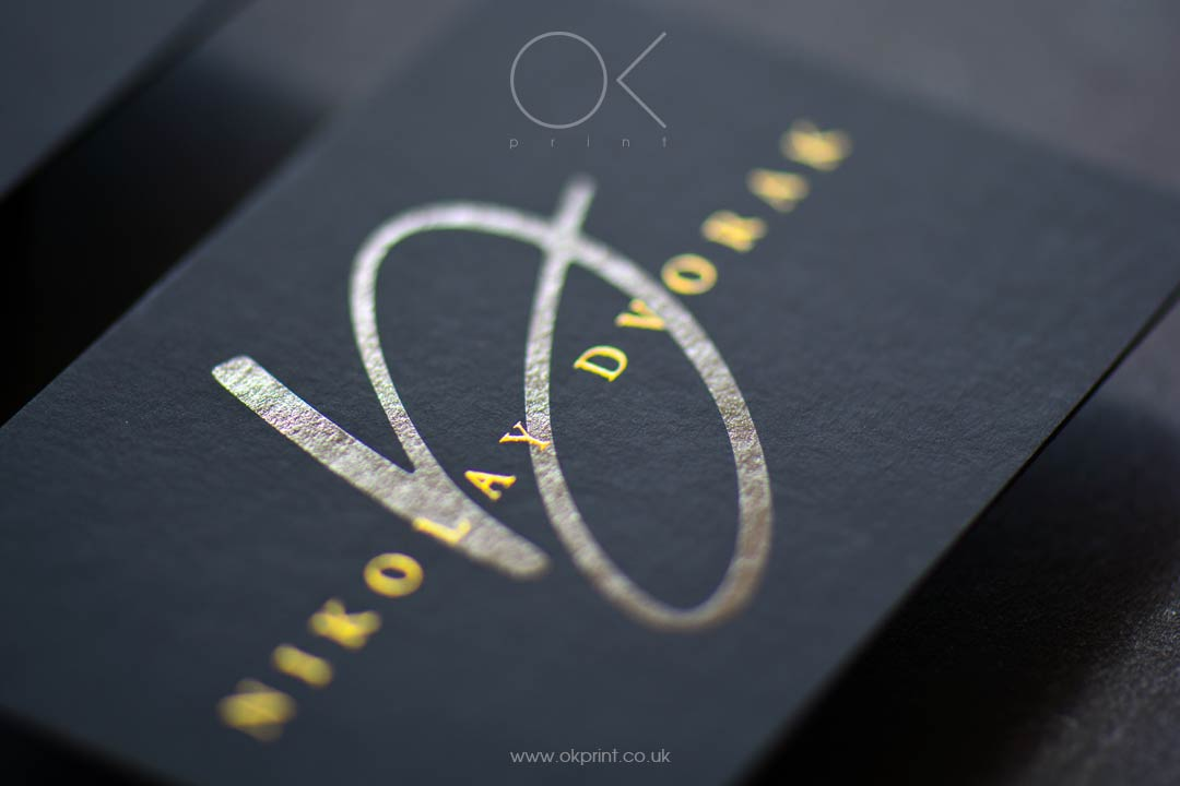 Premium business cards with golden ink and black spot
