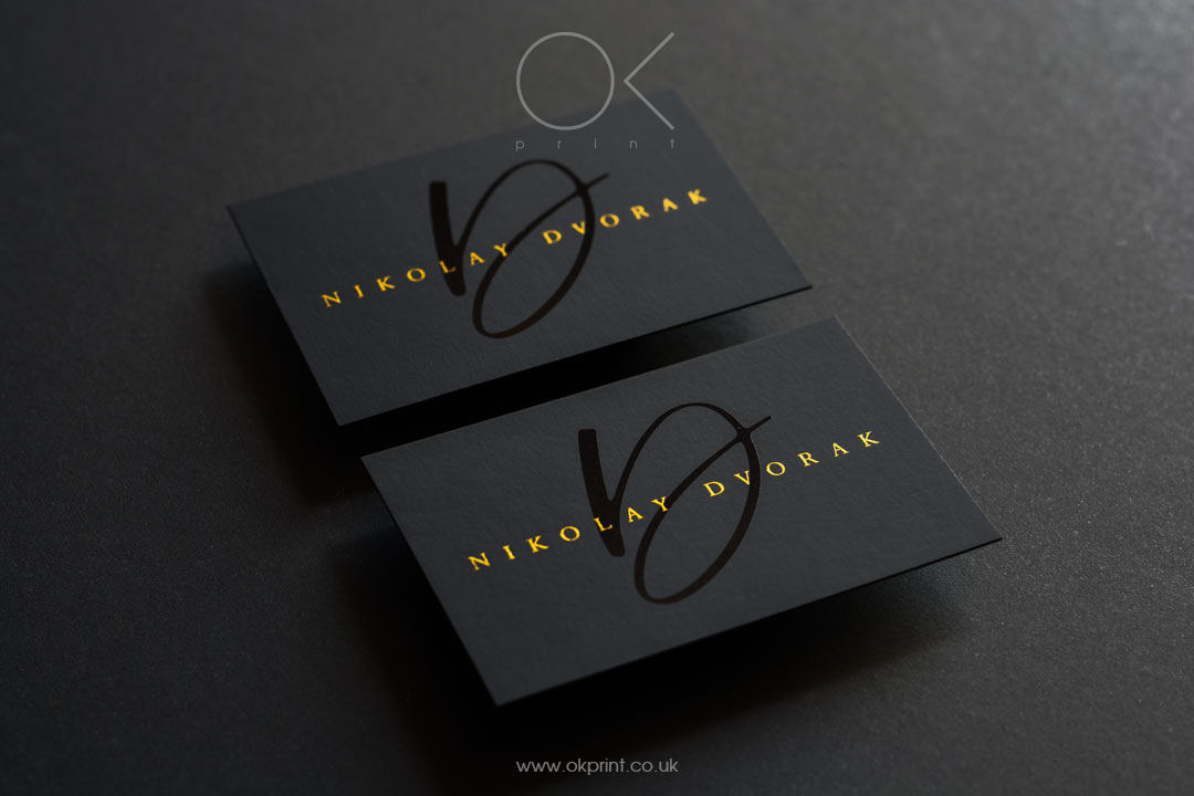 Premium black business cards with golden ink and black spot